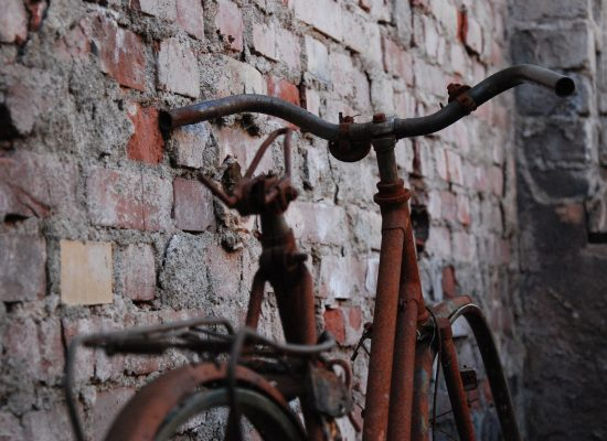 Rusty Bike leaning against a wall